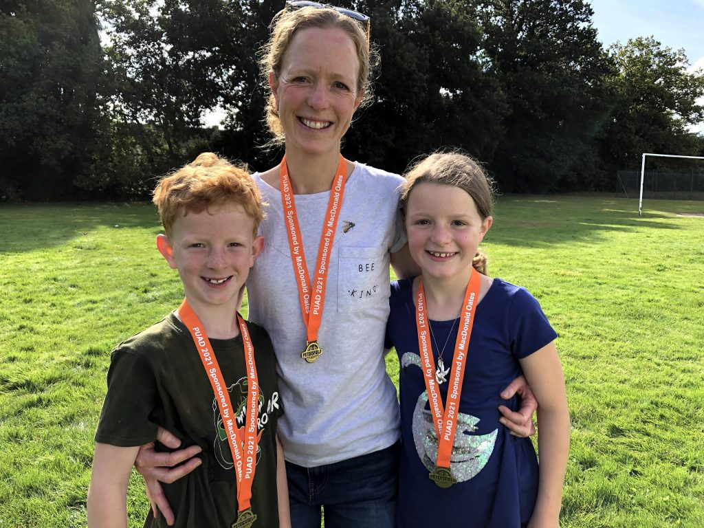 Oliver, Katie and Beatrice were first around the five mile route. They're wearing their orange medals.